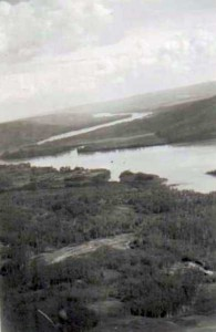 Fort St. John (1858-1872) was located on the flat across the Peace River where the river bends. Courtesy of the Fort St. John North Peace Museum